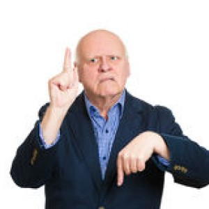 confused-old-man-closeup-portrait-senior-mature-pointing-two-different-directions-not-sure-which-way-to-go-life-hesitant-to-40113405