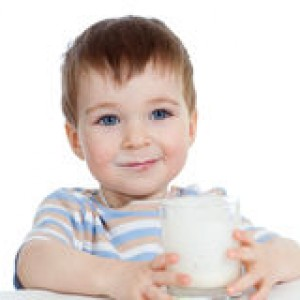 little-child-drinking-yogurt-over-white-23797260