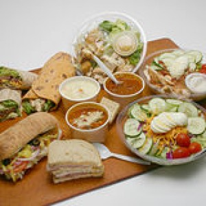 wraps-salads-sandwiches-soups-variety-deli-type-sitting-cutting-board-white-background-49190476