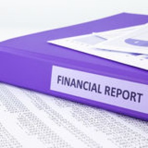 financial-accounting-report-sale-purchase-statement-purple-binder-place-concept-to-46090942